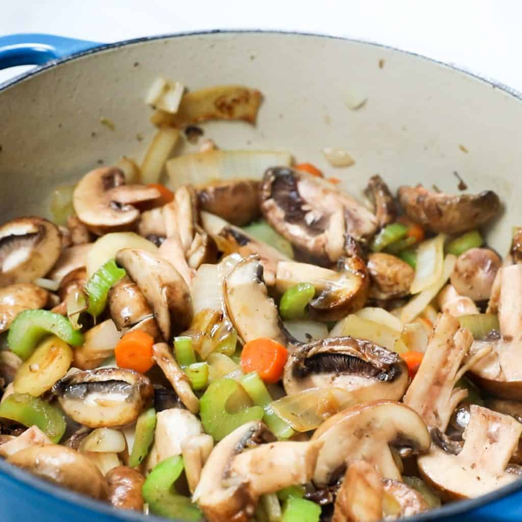 mushrooms added to the pan with the onion mixture
