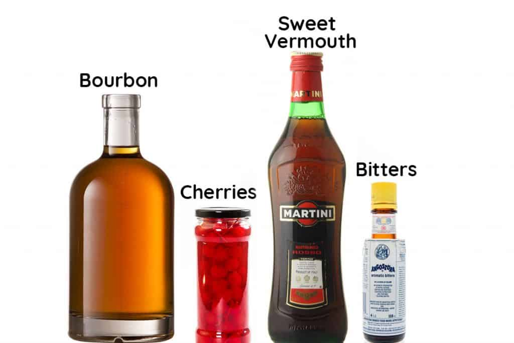 A bottle of bourbon, vermouth, bitters and jar of cherries
