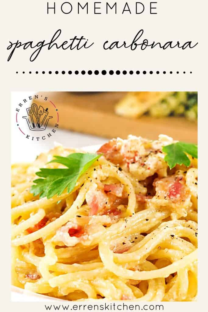 Spaghetti Alla Carbonara on a plate with garlic bread in the background