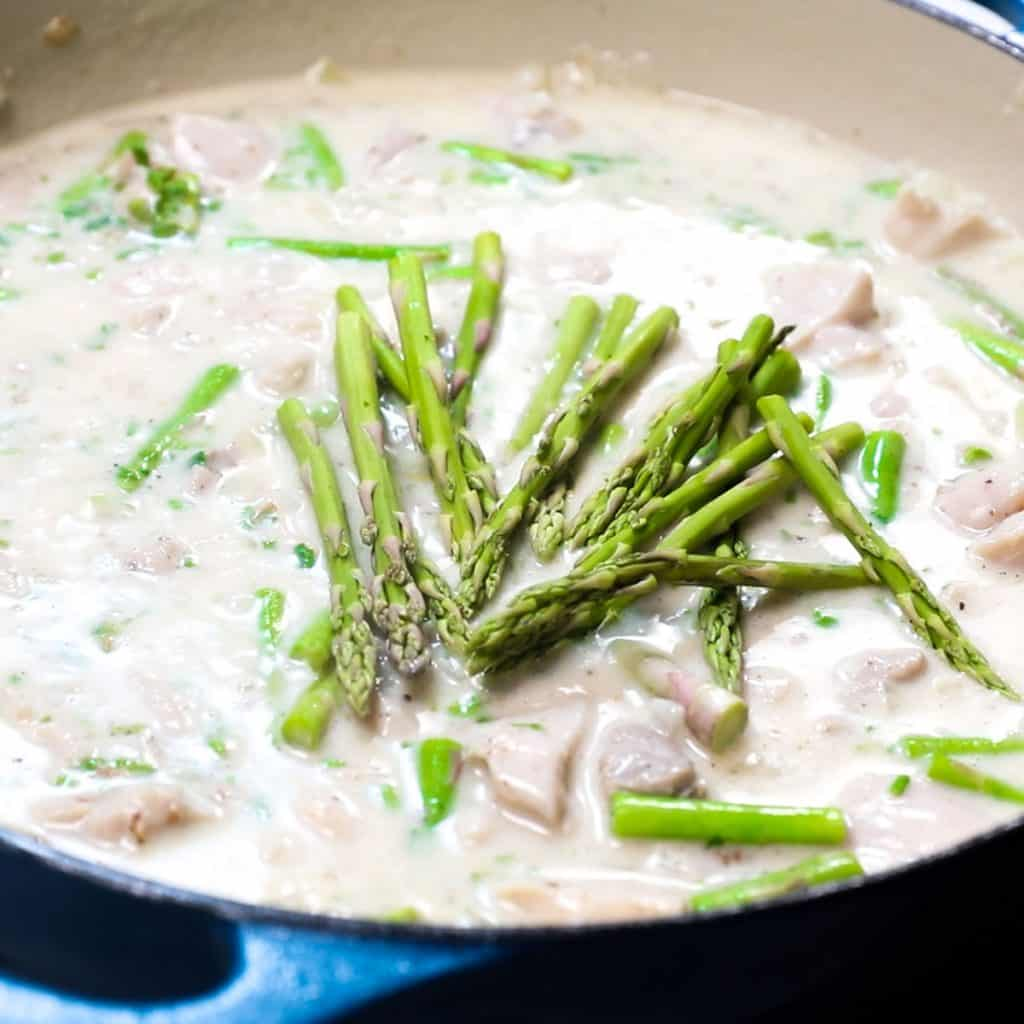 the asparagus tips added to the pan with the chicken mixture