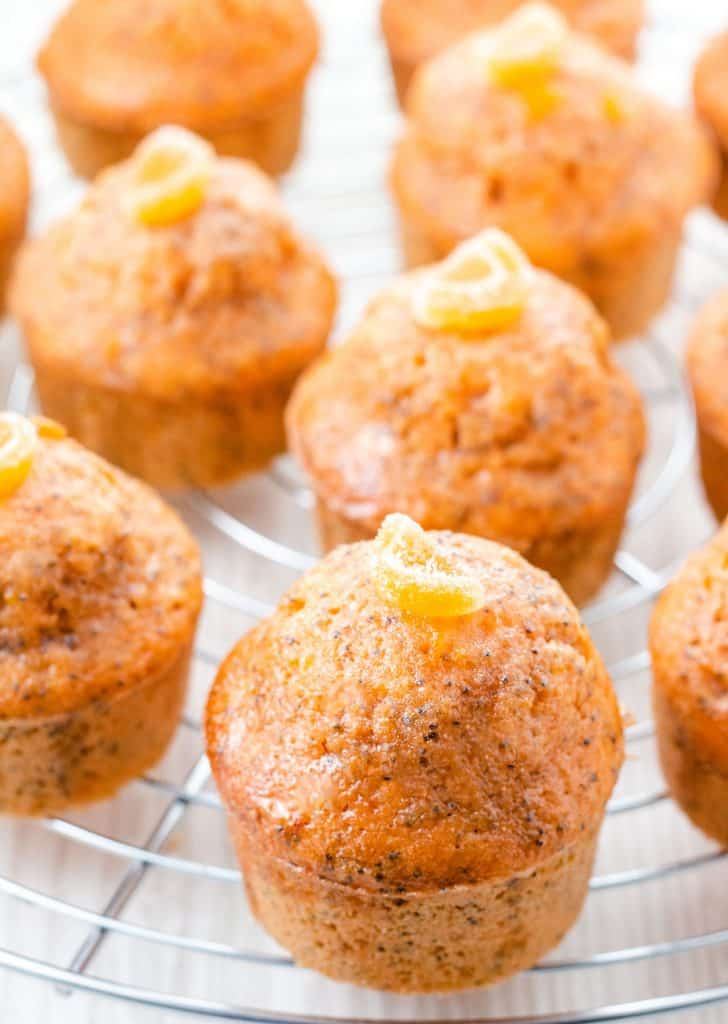 a close up of orange poppy seed cakes ready to eat.
