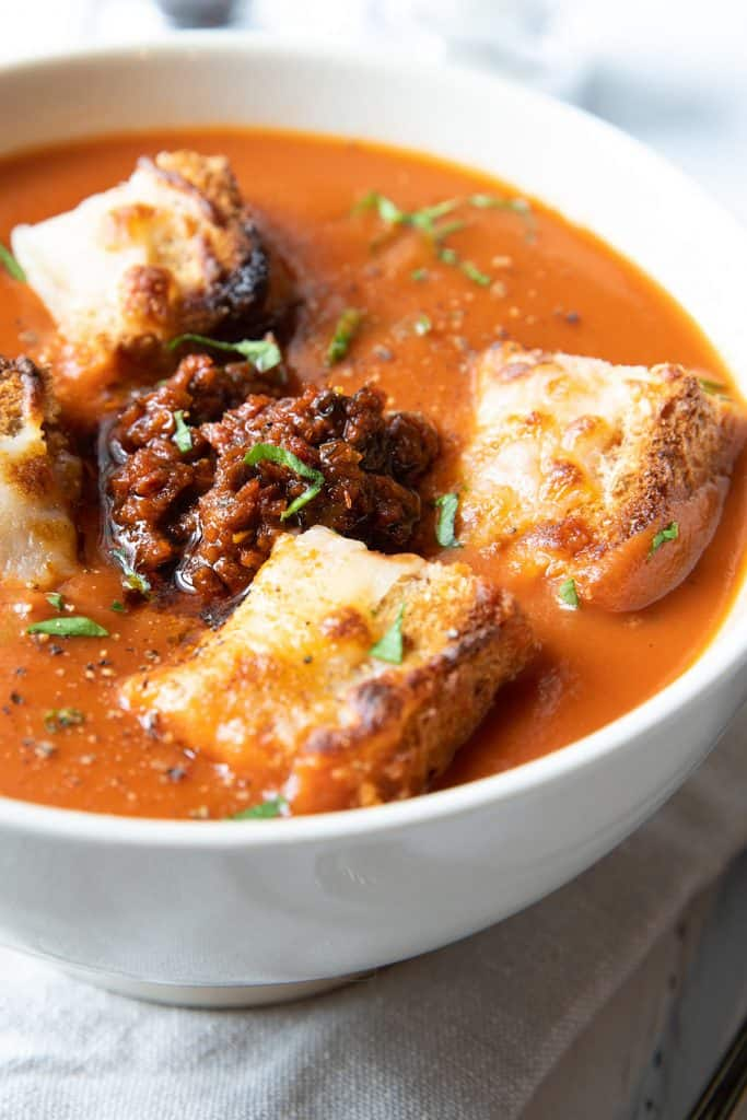 Tomato Pesto Soup topped with cheesy croutons