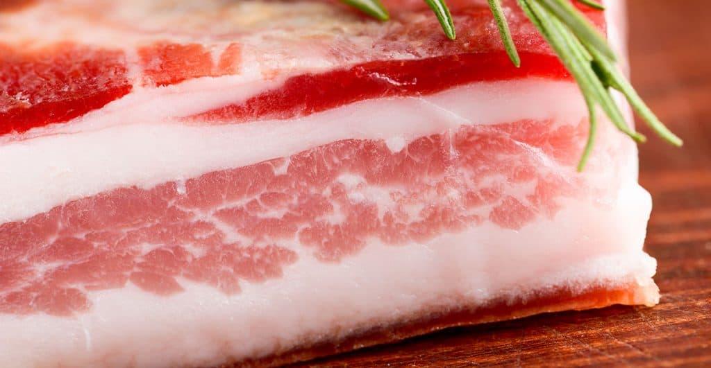 cured pork on a cutting board