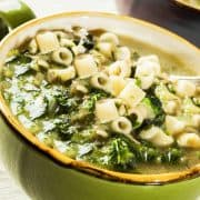 a bowl of escarole soup with pasta