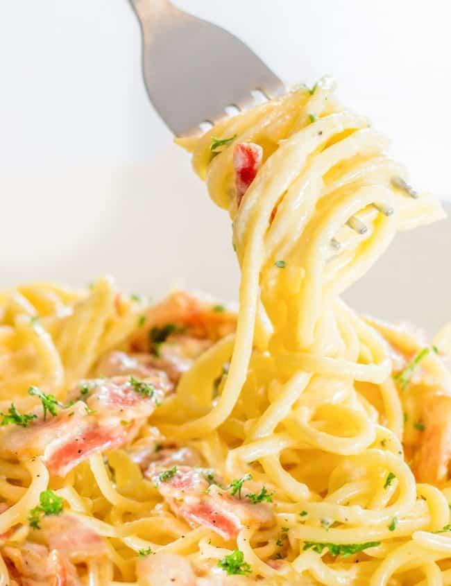 a fork twirling spaghetti Carbonara