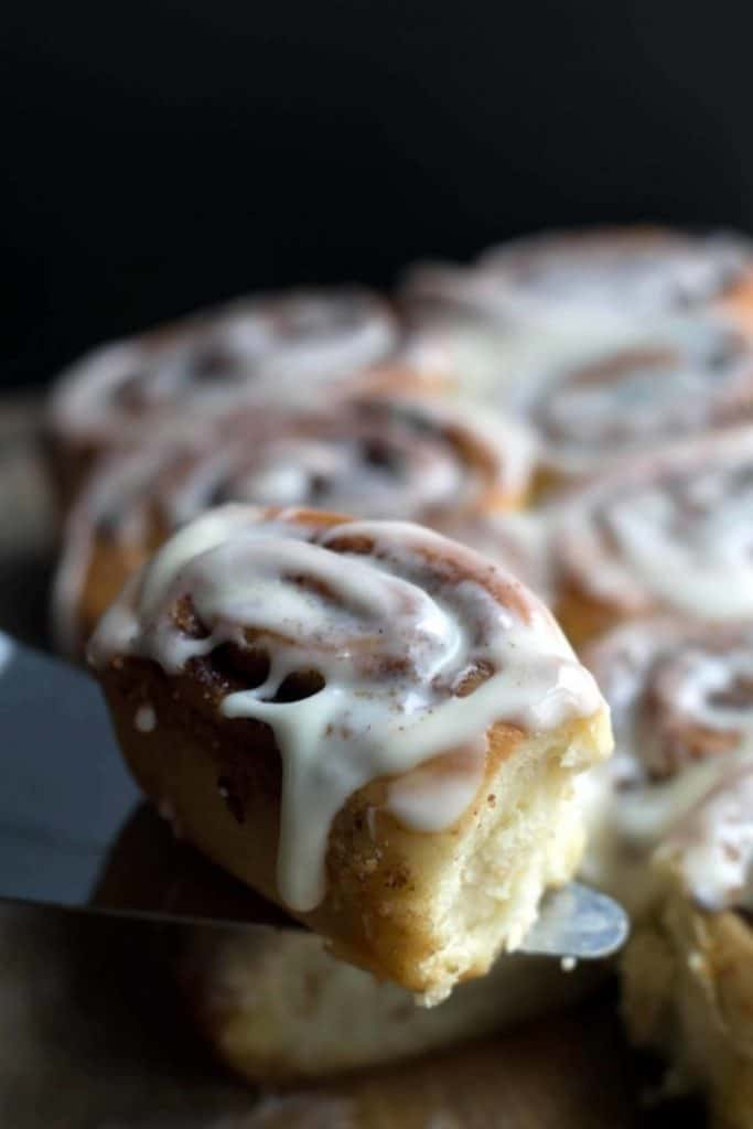 a cinnamon roll, iced and ready to eat