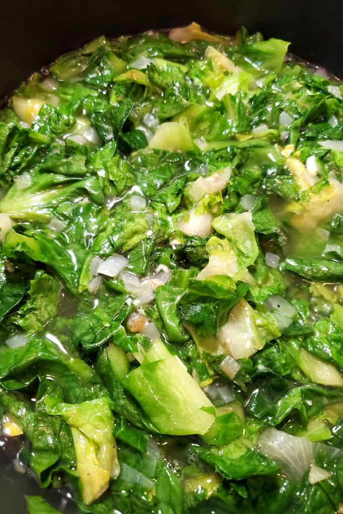 the escarole added to the stock mixture