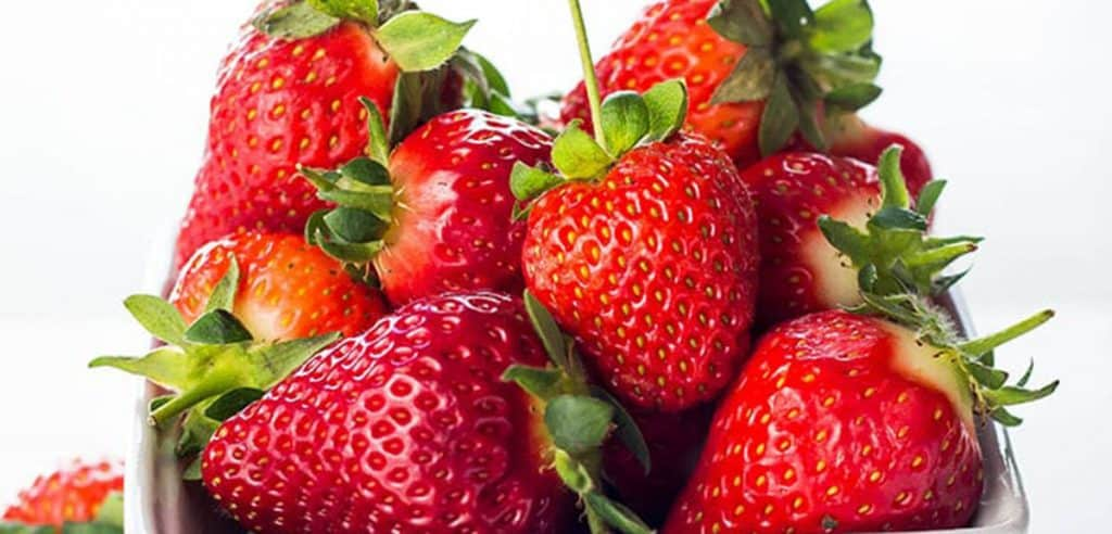 a pile of strawberries