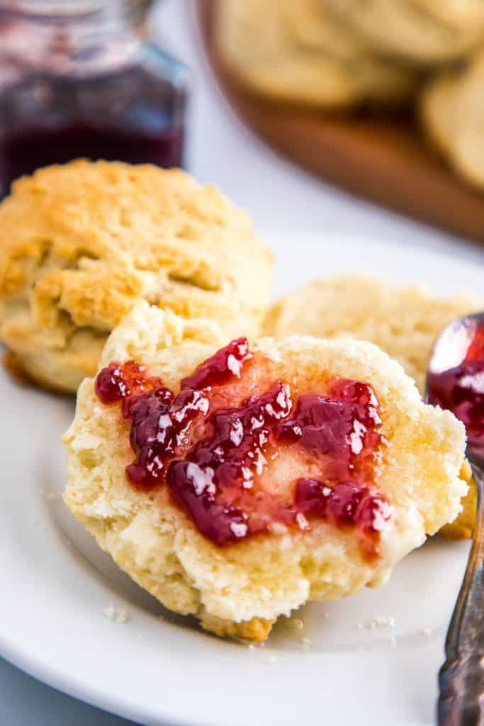 drop biscuits cut in half with jam spread on them