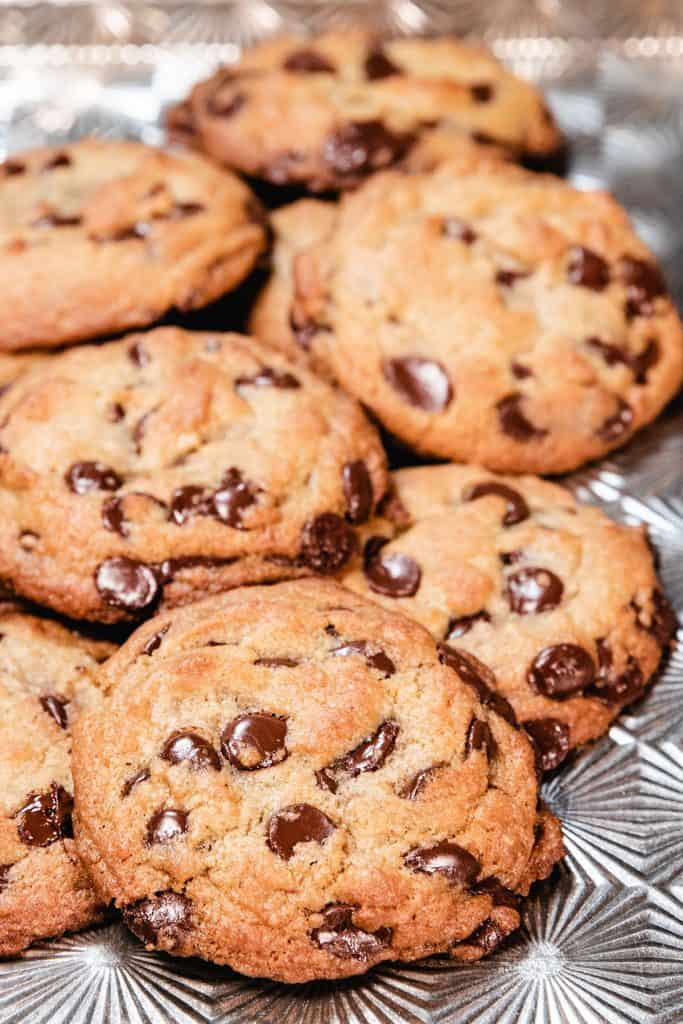 a pan piled with fresh baked chocolate chip cookies