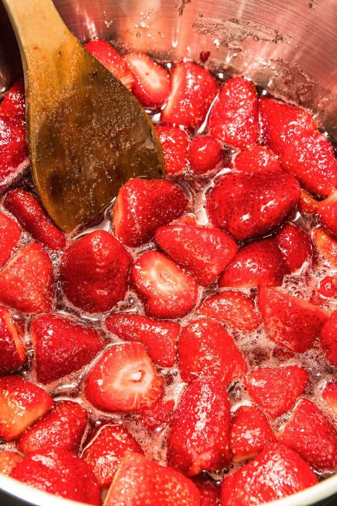 strawberries in a pot being stirred