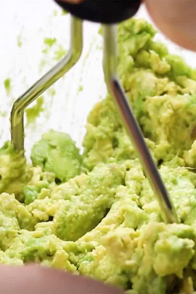 avocados being mashed