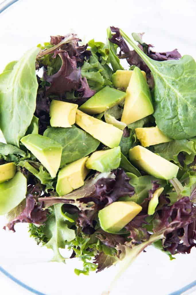 avacado and salad greens in a bowl