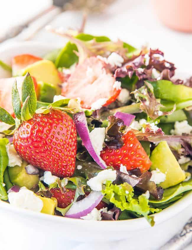 a bowl of fresh strawberry salad