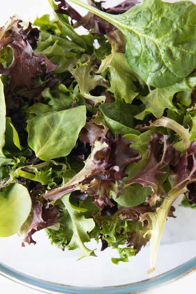 a bowl full of salad greens