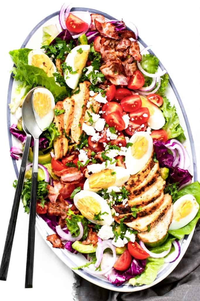 Homemade Cobb salad served in an oval dish, overhead view