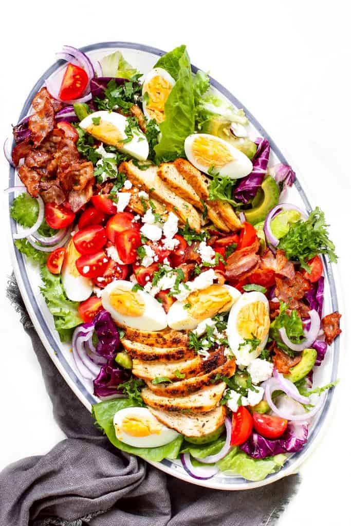 overhead shot of a cobb salad on a platter