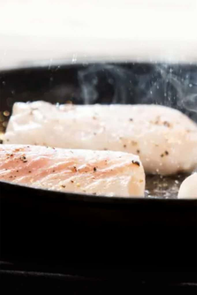 cod fillets in a pan ready to cook