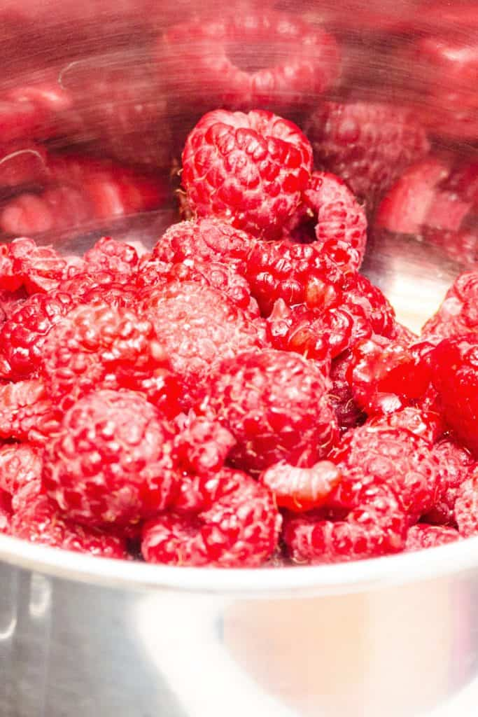 raspberries added to a saucepan
