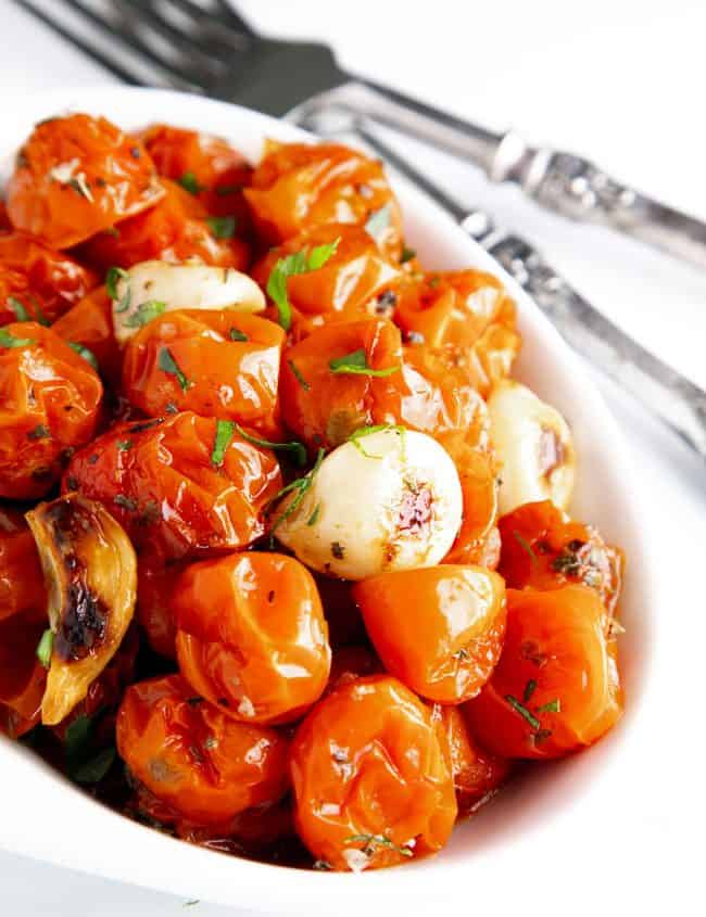 a bowl of roasted cherry tomatoes ready to serve