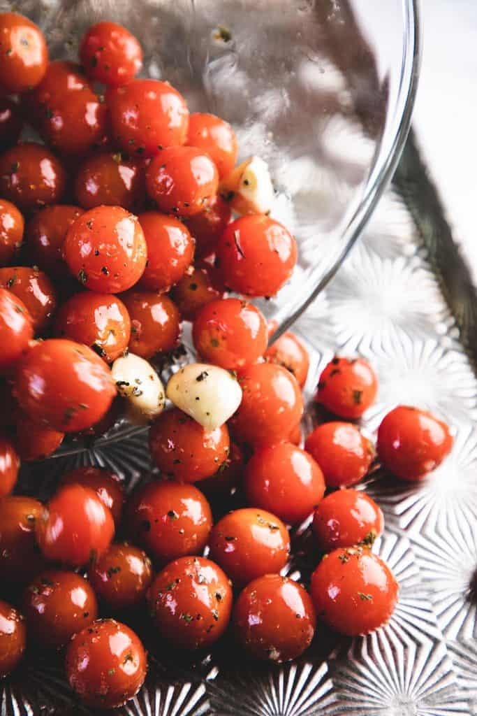 oil being poured onto cherry tomatoes
