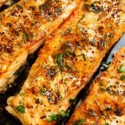 salmon basted in garlic butter with lemon wedges