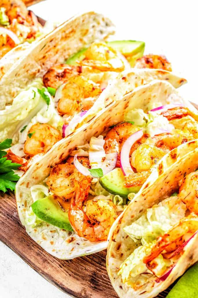 Seafood tacos with slaw, red onion and avacado