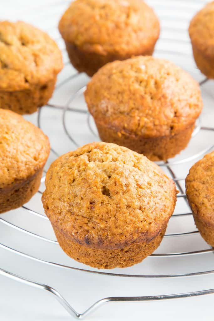banana bread muffins cooling on a rack