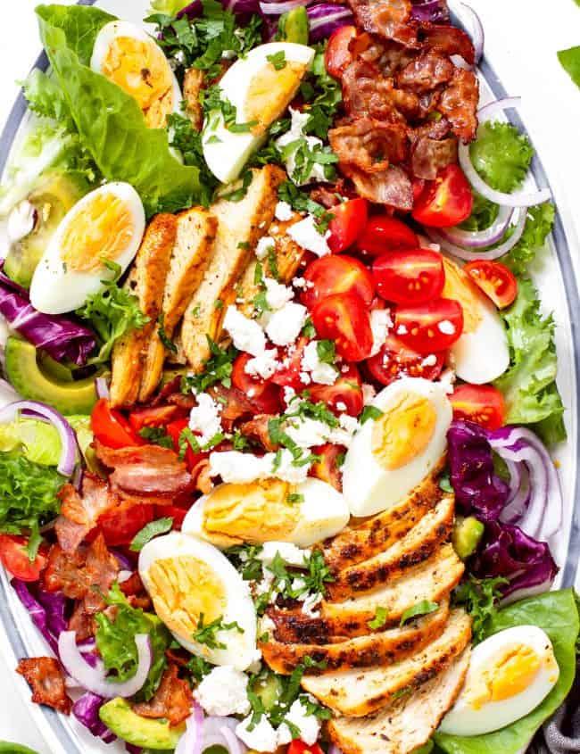 overhead, close up shot of a cobb salad on a platter