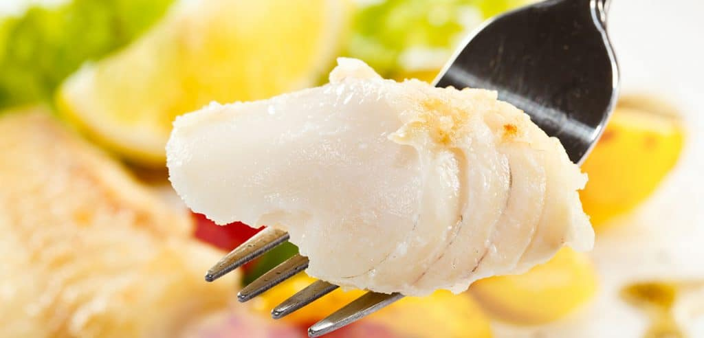 a forkful of cooked cod