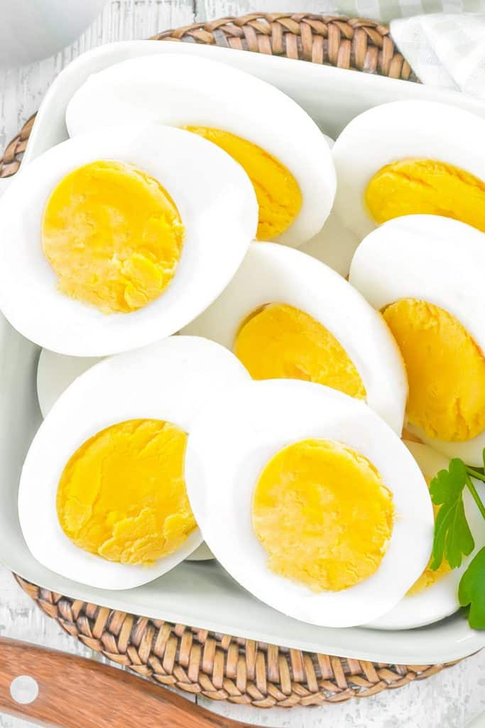 above view of halved hard boiled eggs in a bowl