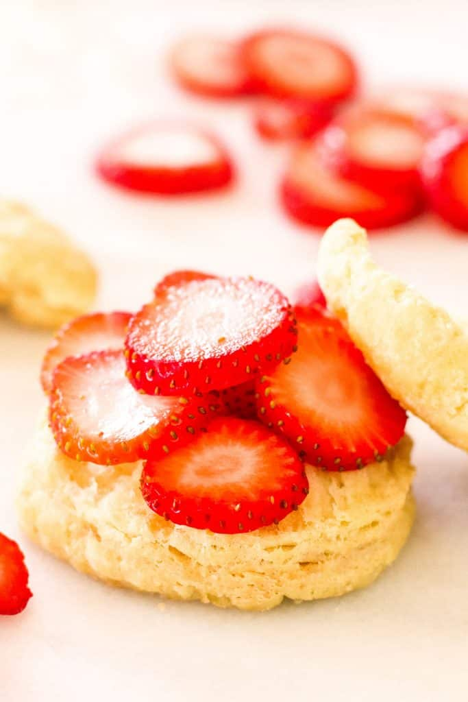 sliced strawberries on a biscuit