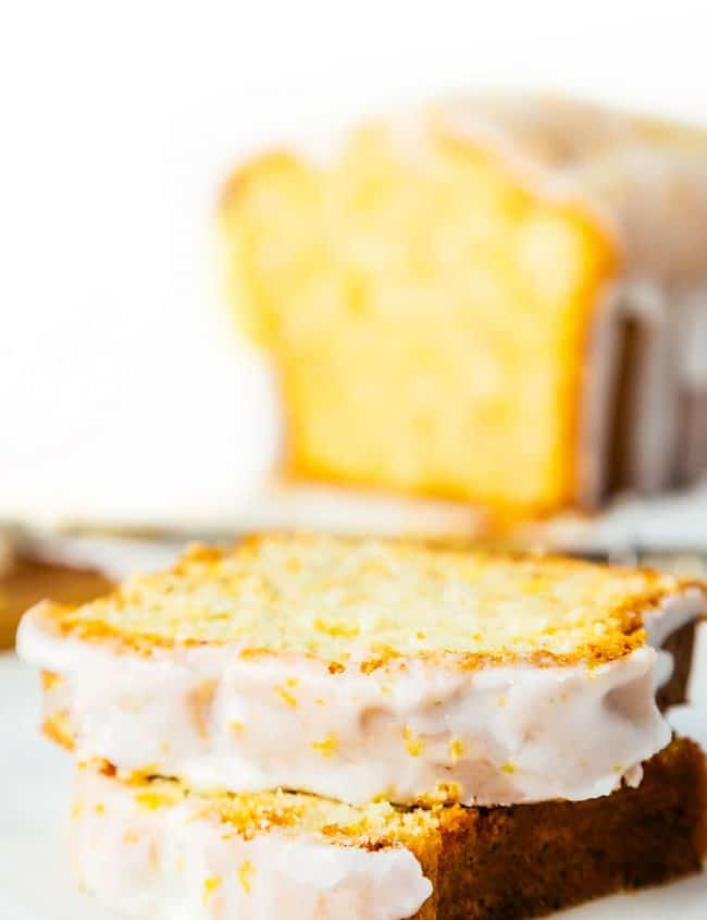 slices of glazed lemon pound cake with the cake in the background